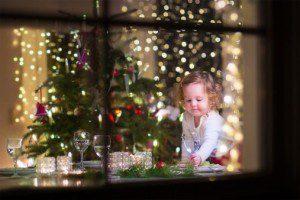 child at christmas tree